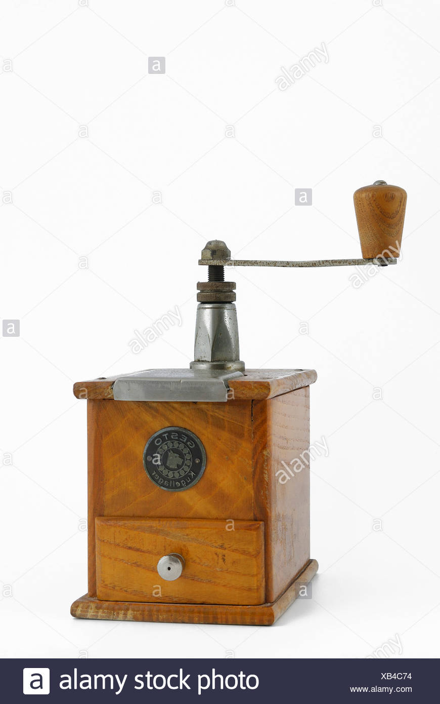 Antique manual coffee mill - Stock Image