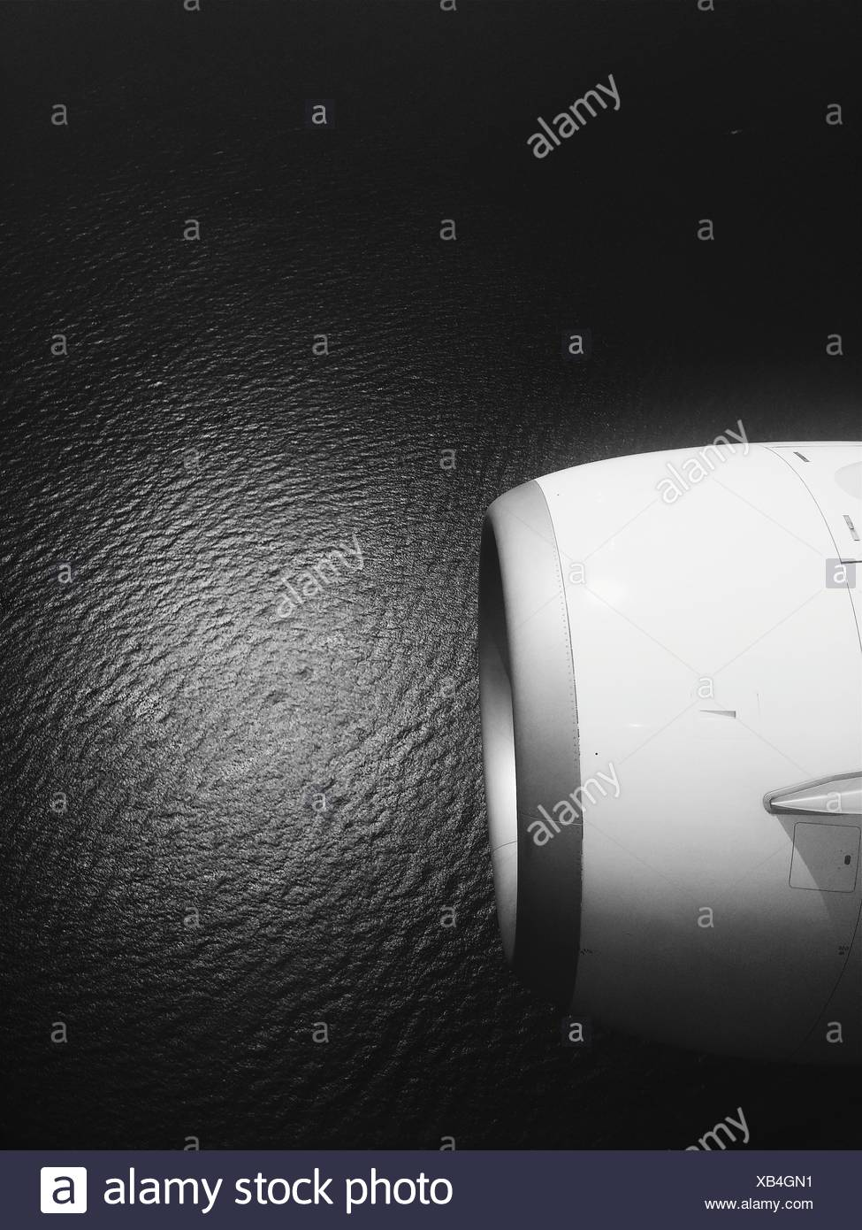 Cropped Image Of Jet Engine Over Sea - Stock Image