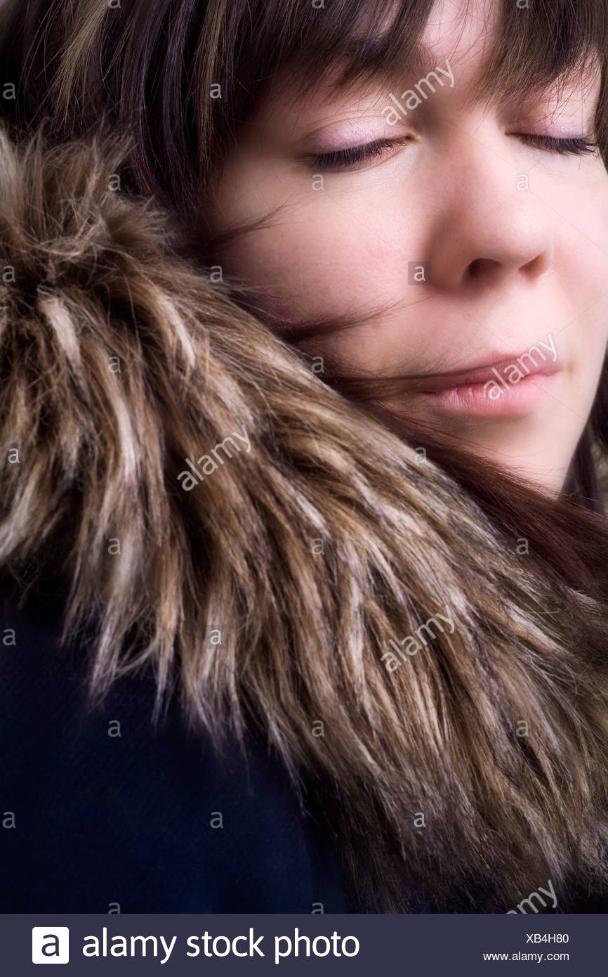 Portrait of woman with furry coat Stock Photo