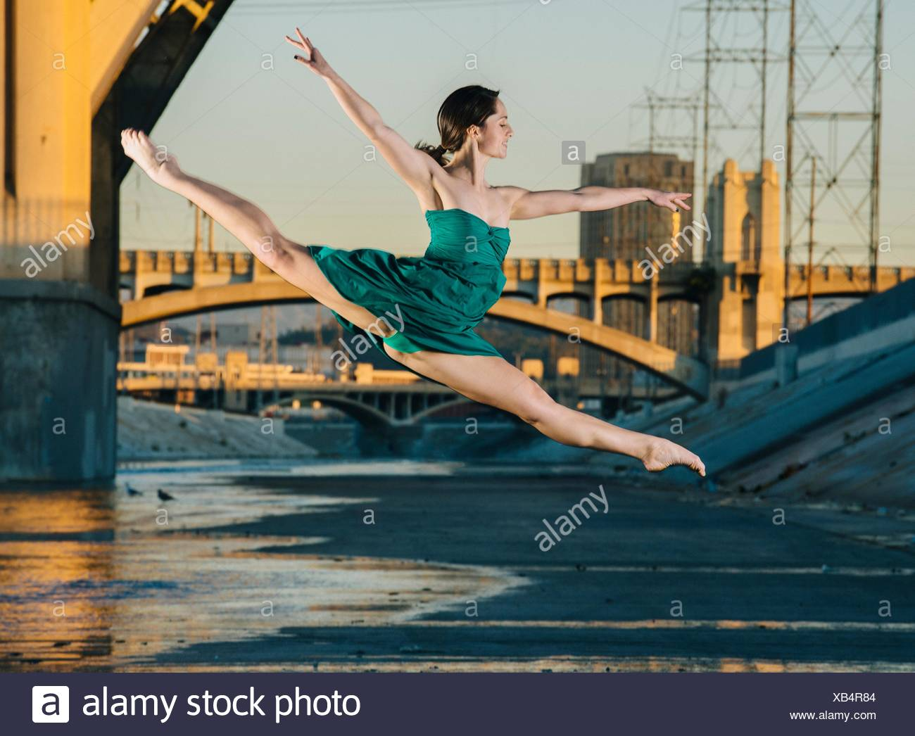 Young female dancer leaping in mid air, Los Angeles, USA - Stock Image