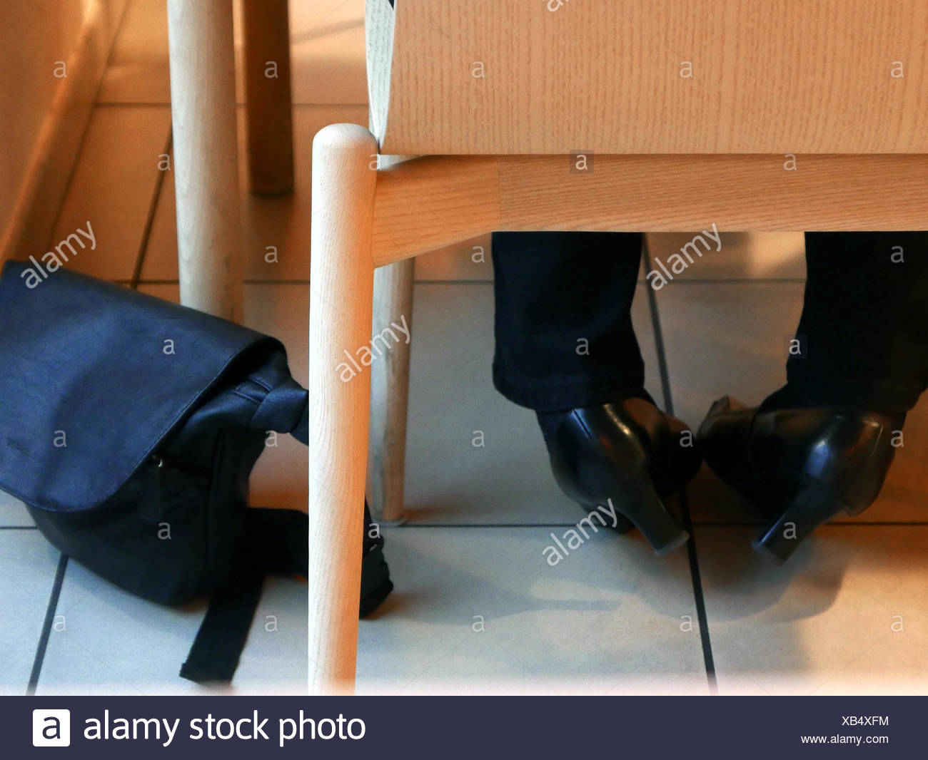 Low Section Of Woman With High Heels At Restaurant - Stock Image