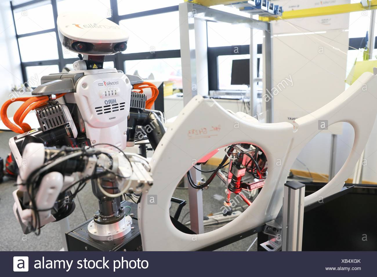 Robot with two arms for flexible robotics. Humanoid robot for automotive assembly tasks in collaboration with people, Industry, Tecnalia Research & - Stock Image