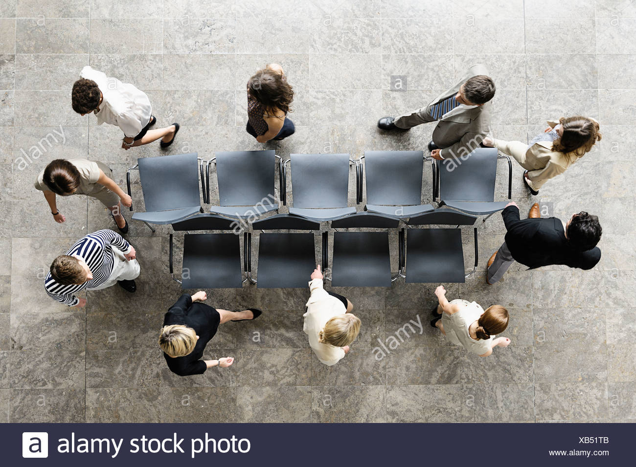 Business people playing musical chairs - Stock Image