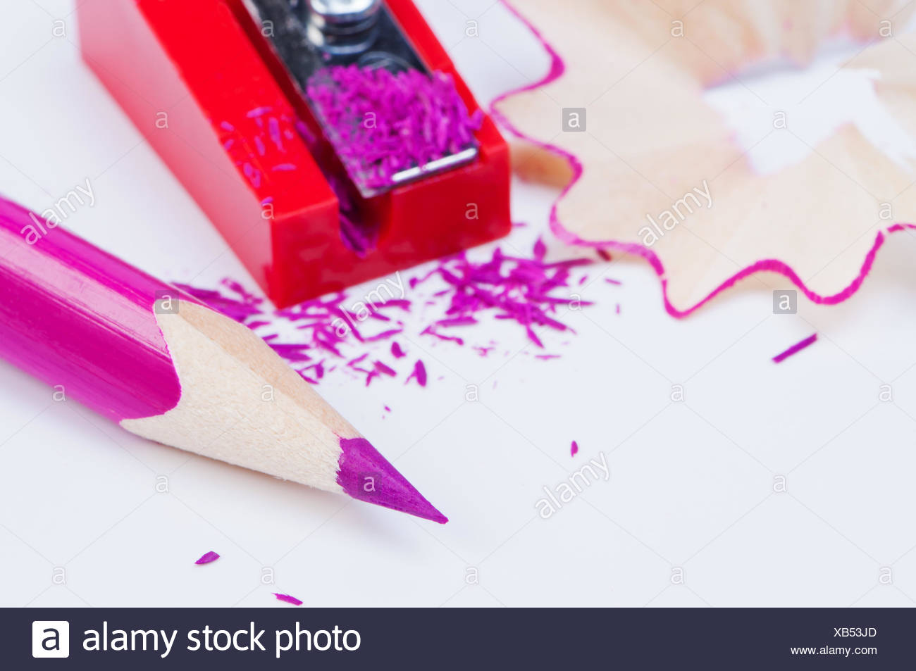Colored pencil with sharpener close-up. - Stock Image
