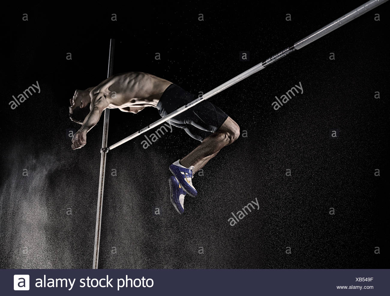 Athlete doing a high jump - Stock Image