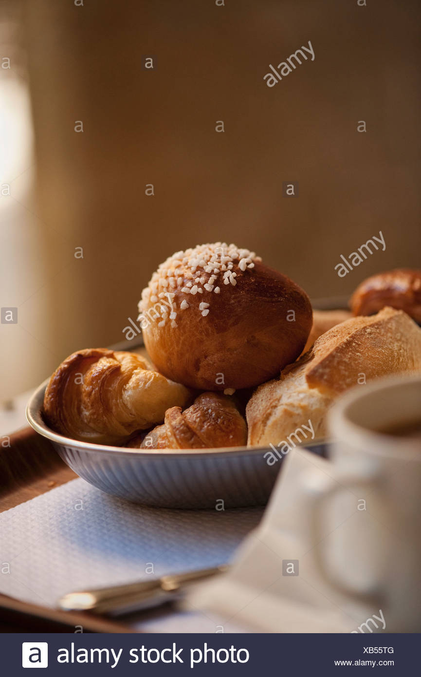 Bowl of breakfast pastries - Stock Image
