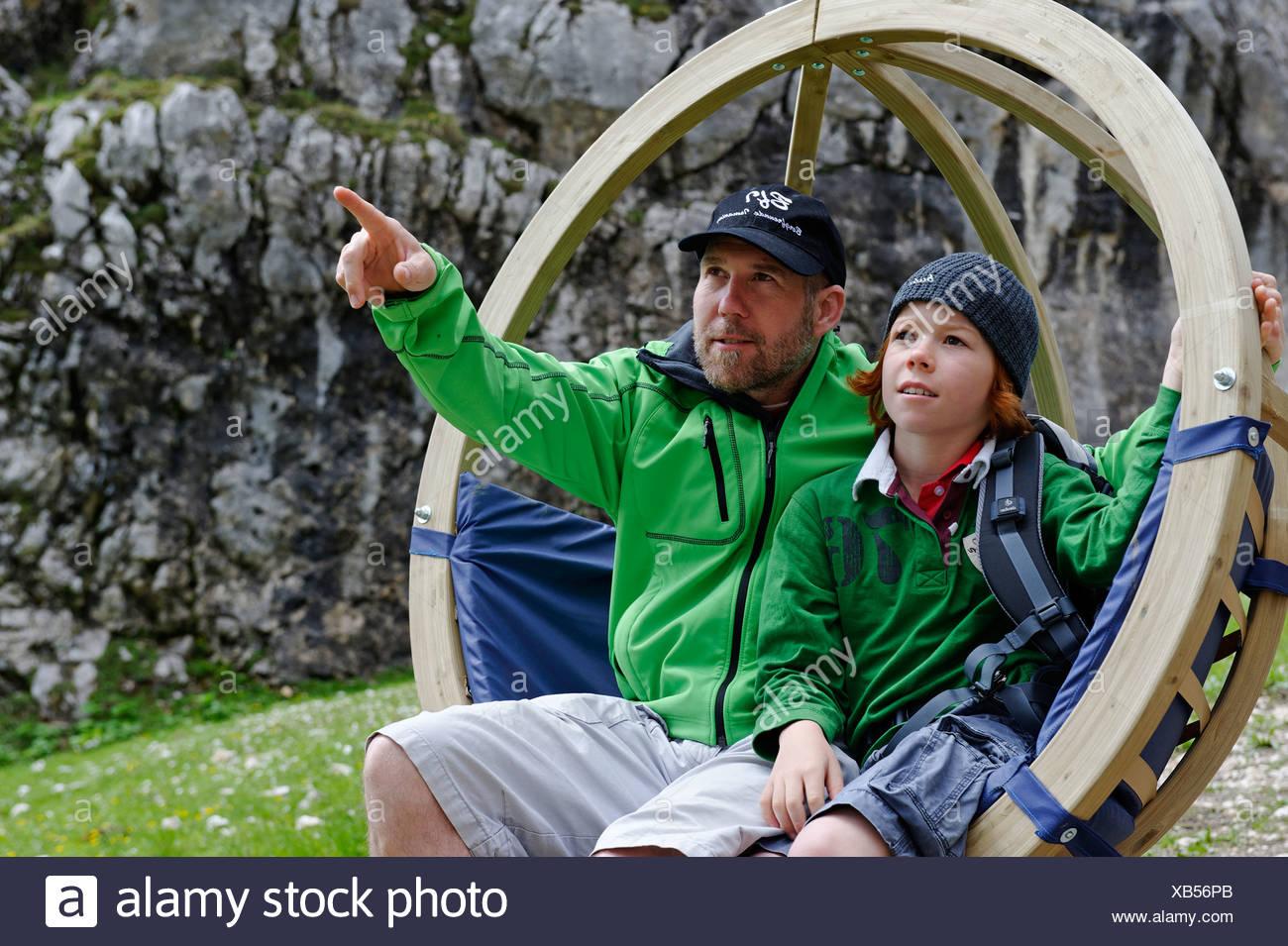 Father and son on the Gipfel-Erlebnisweg, summit adventure trail at Alpspitzbahn, Garmisch-Partenkirchen, Wetterstein range - Stock Image