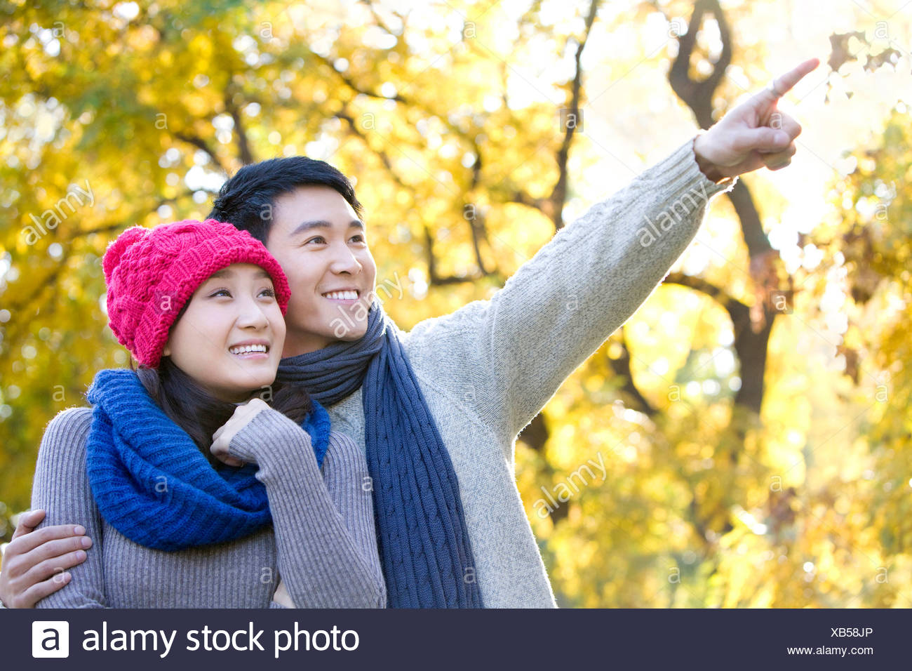 Young Couple Enjoying a Park in Autumn Stock Photo