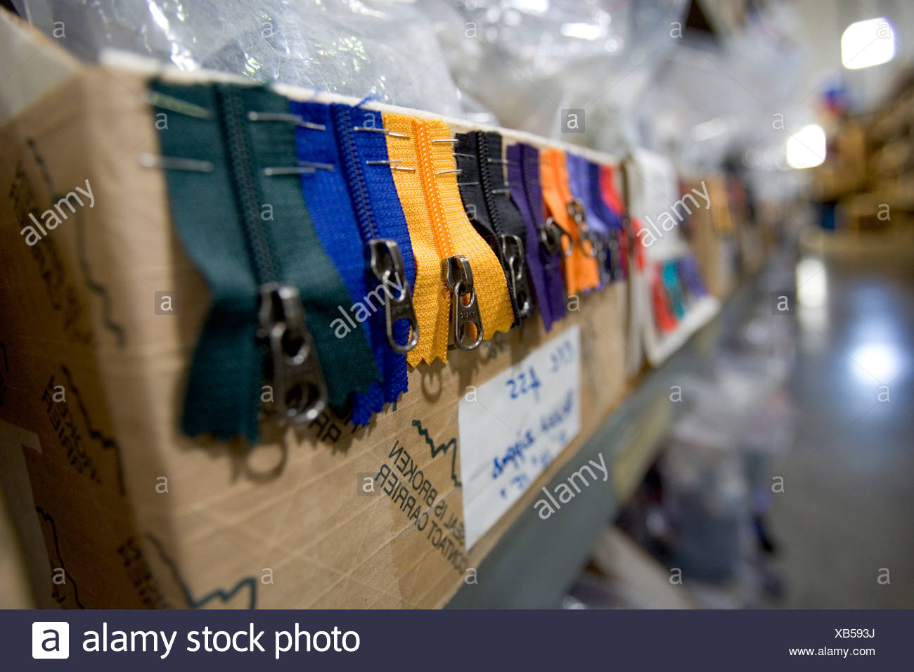 Zippers hanging out of a box in a clothing distribution center in Reno Nevada. Stock Photo