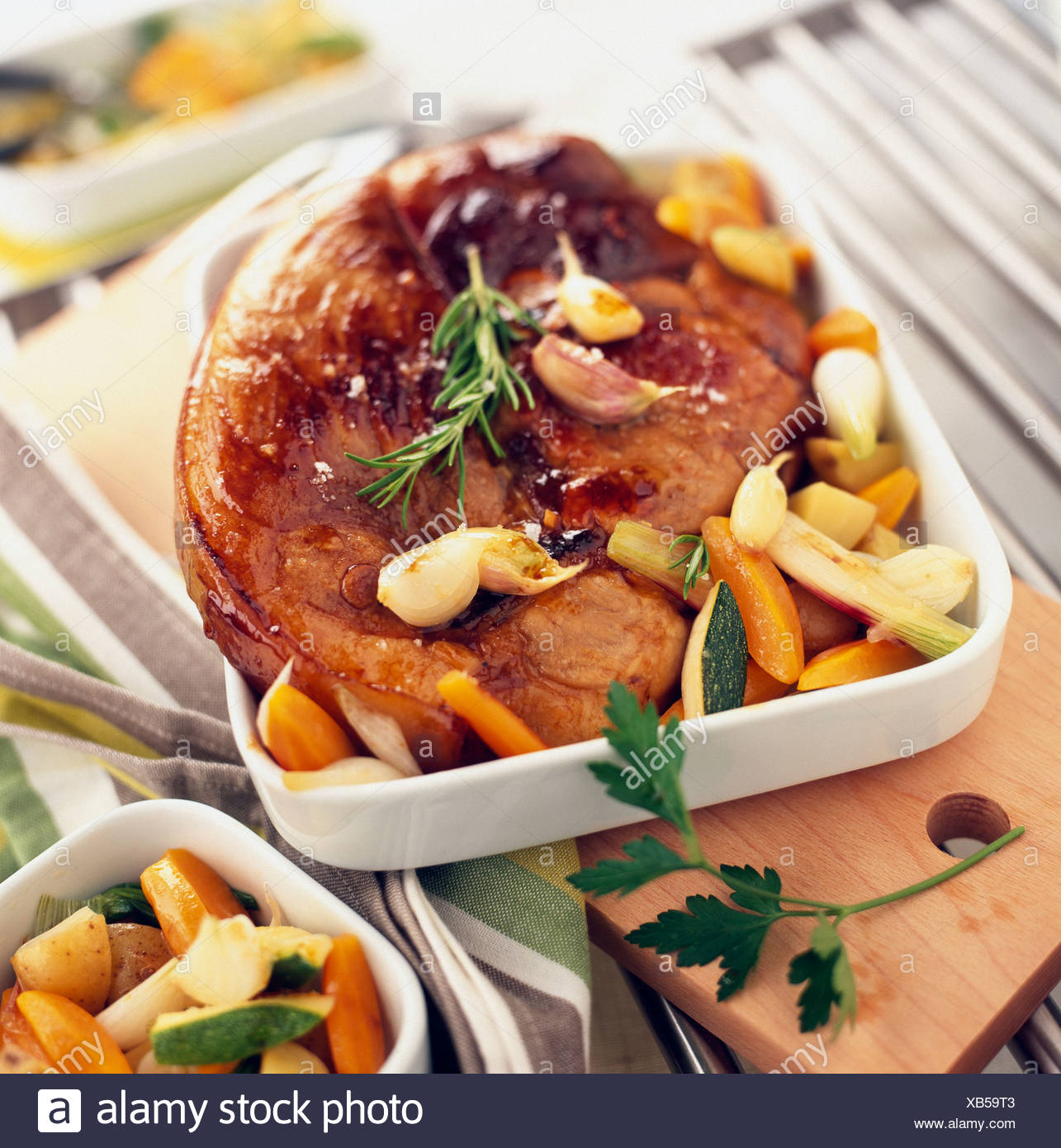 Leg of lamb with garlic and vegetables - Stock Image