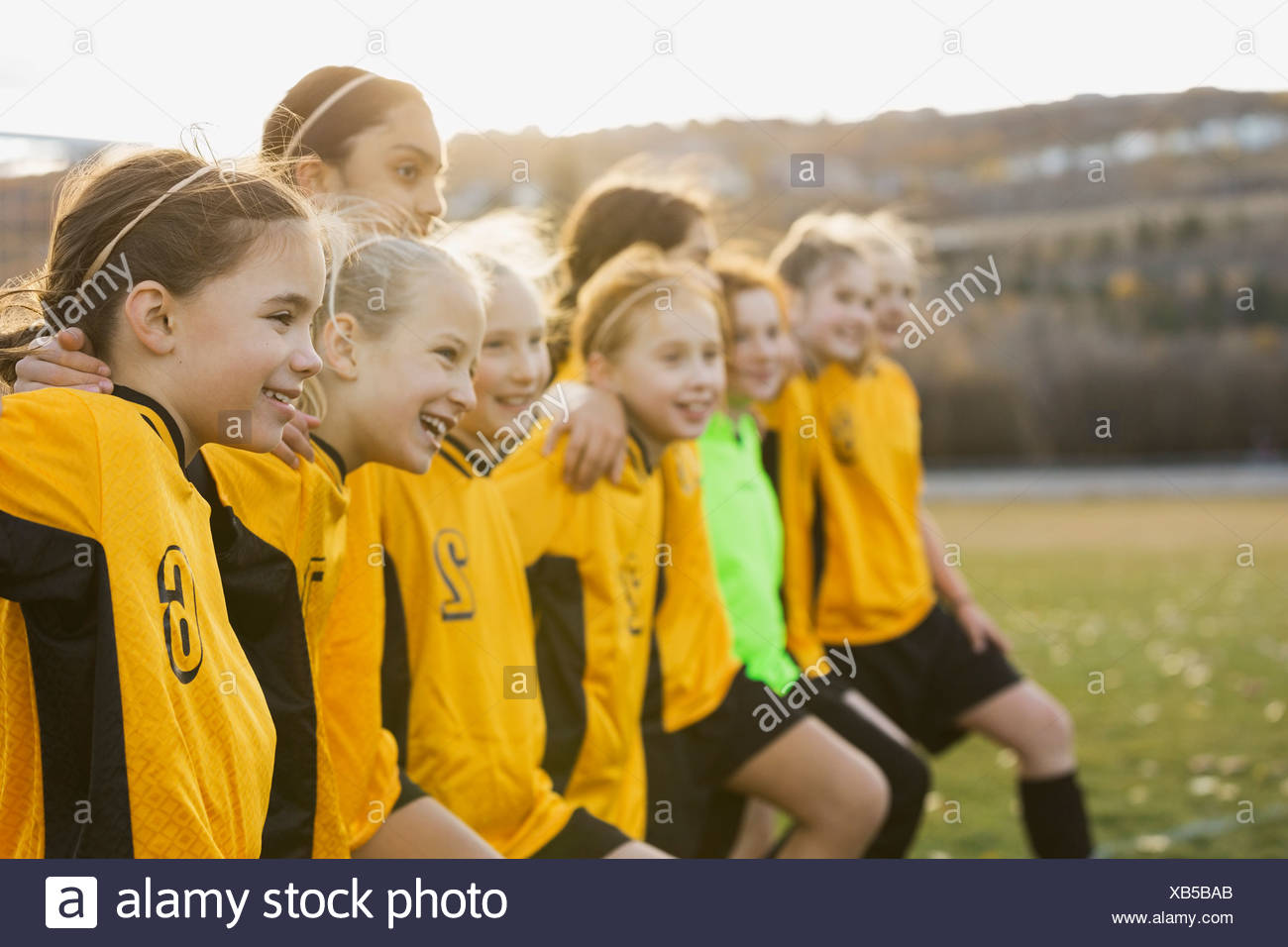 Soccer team lined up on field - Stock Image