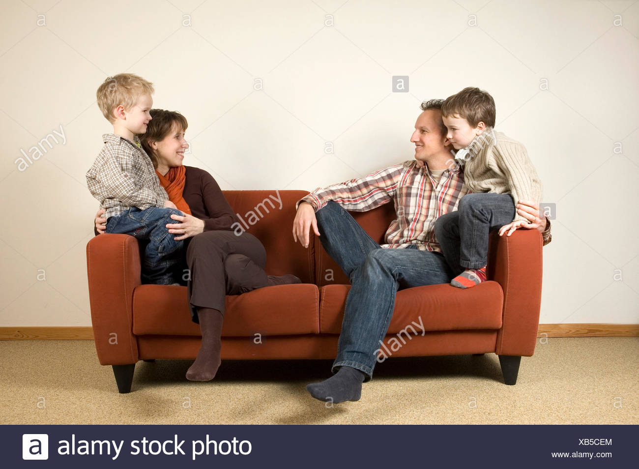 Family On A Couch 1 - Stock Image