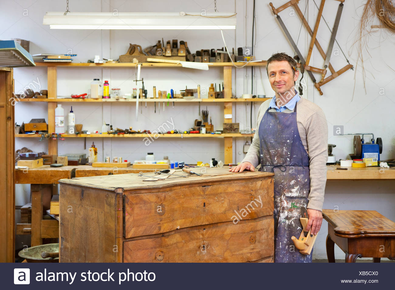 Carpenter working on wooden drawers - Stock Image