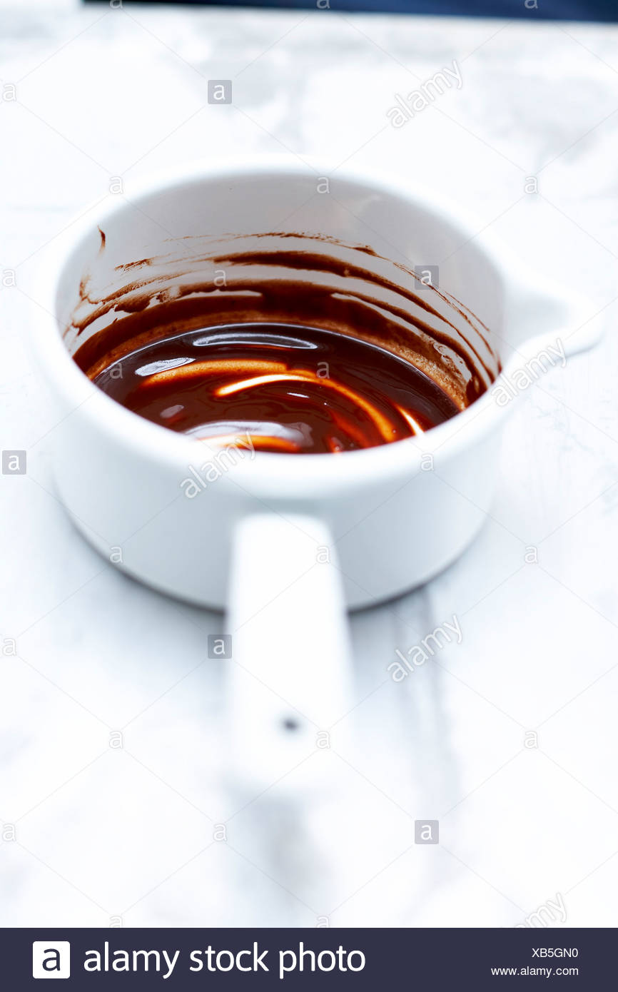Saucepan of melted chocolate - Stock Image