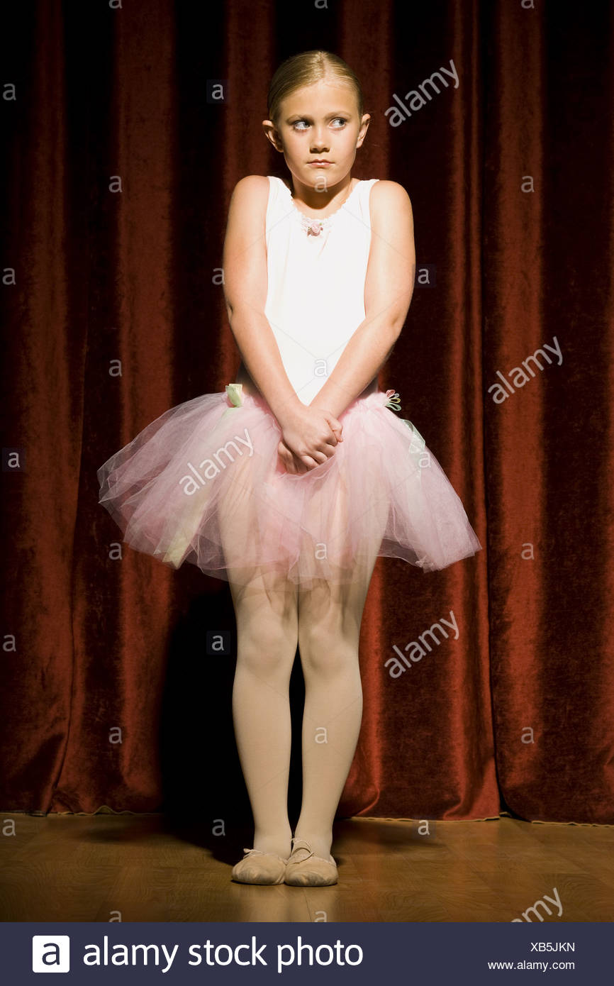 Ballerina girl with hands clasped nervously - Stock Image
