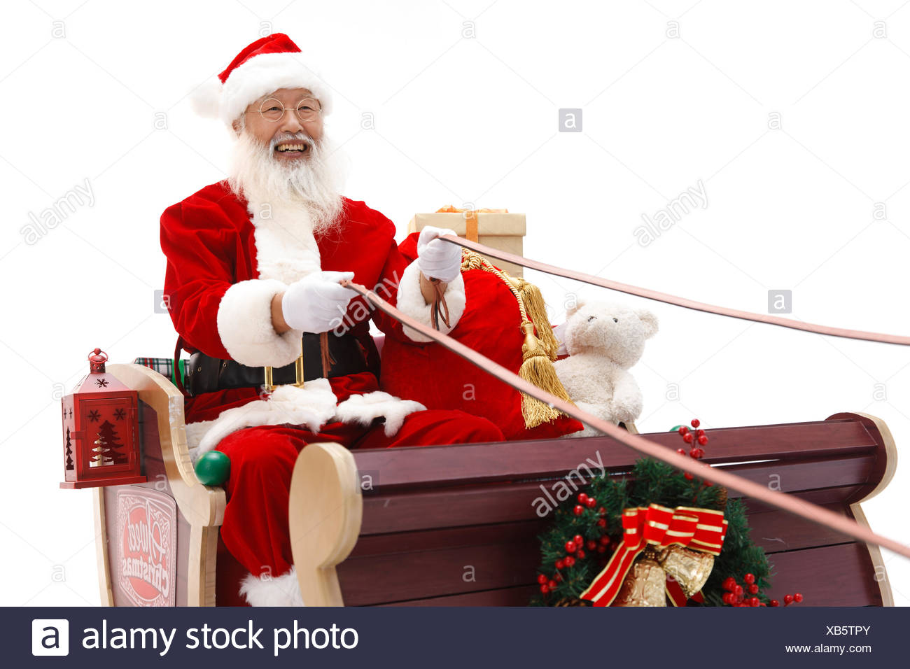 Santa rides the sled to send a gift - Stock Image