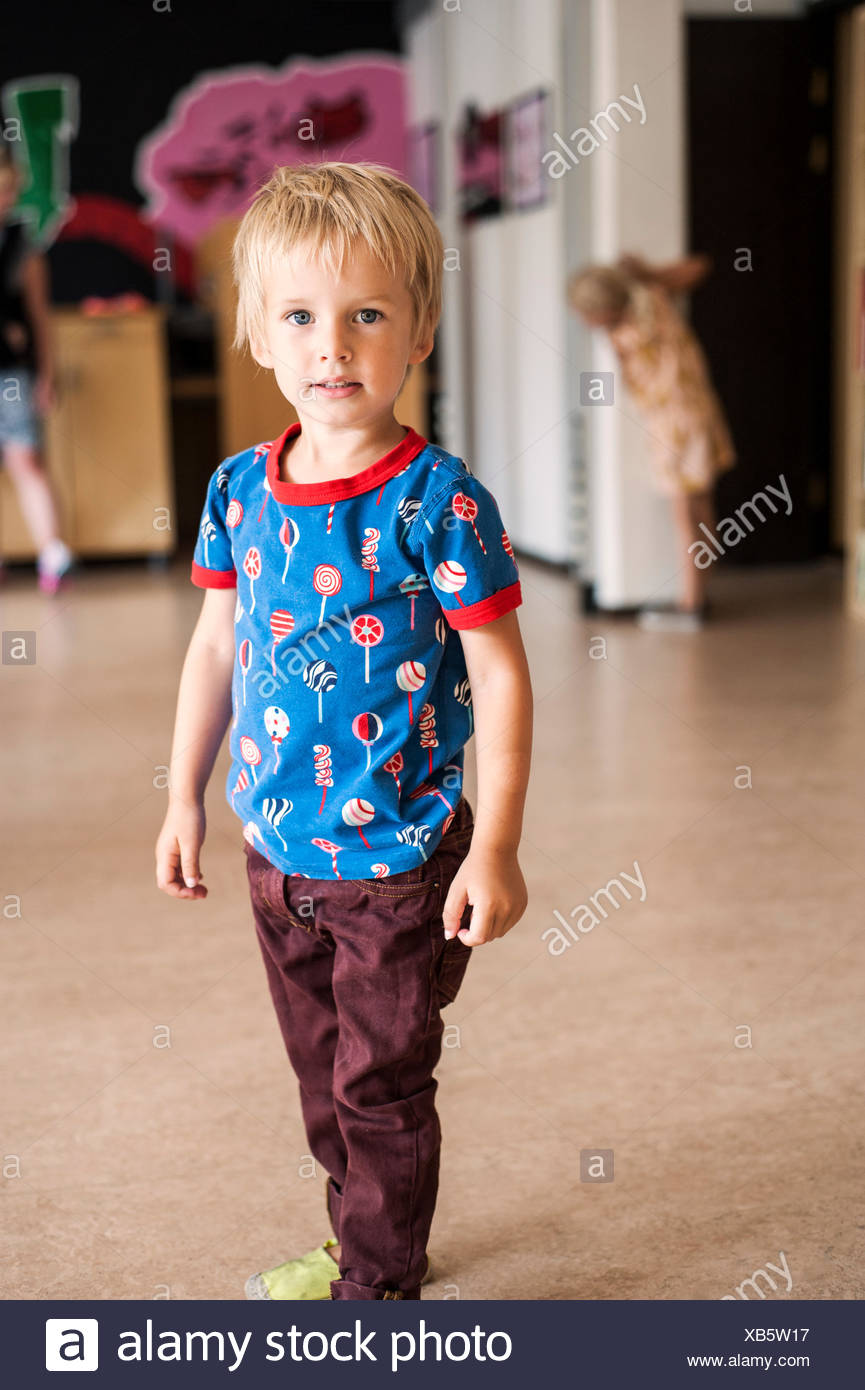 Portrait of cute boy in casuals at primary school - Stock Image