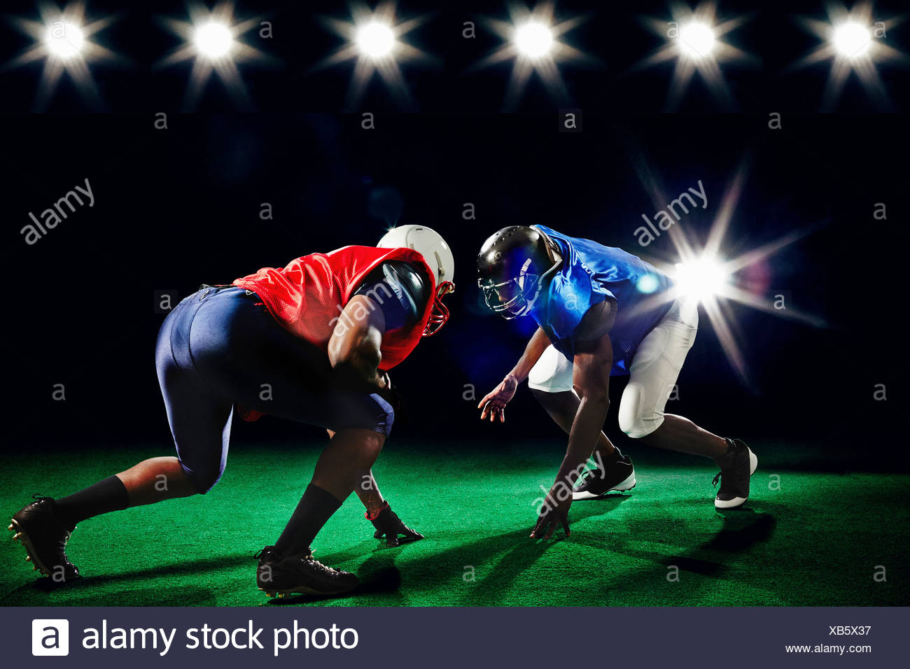 Two american footballers playing head to head - Stock Image