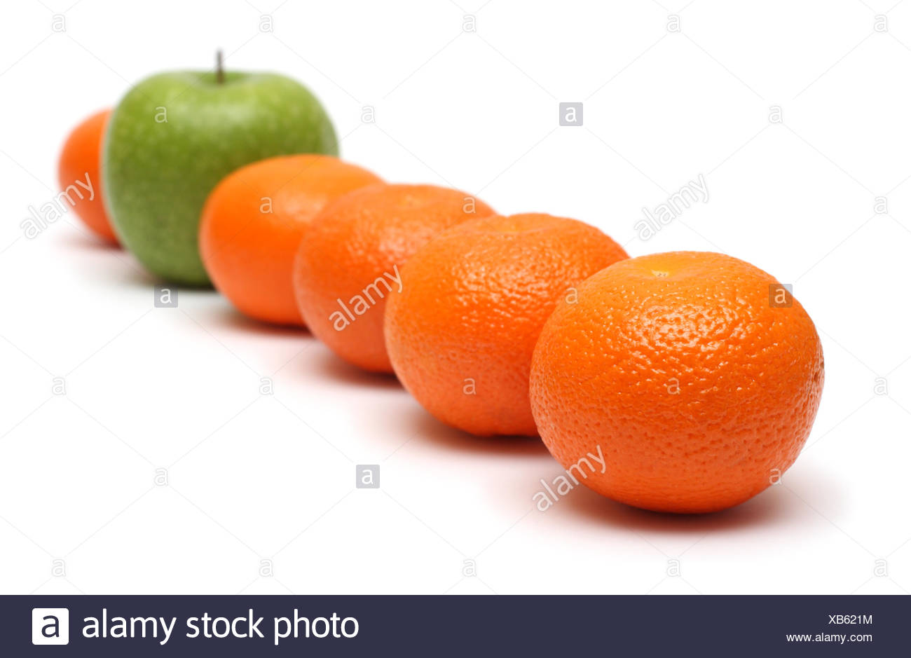 different concepts with mandarins and apple - Stock Image