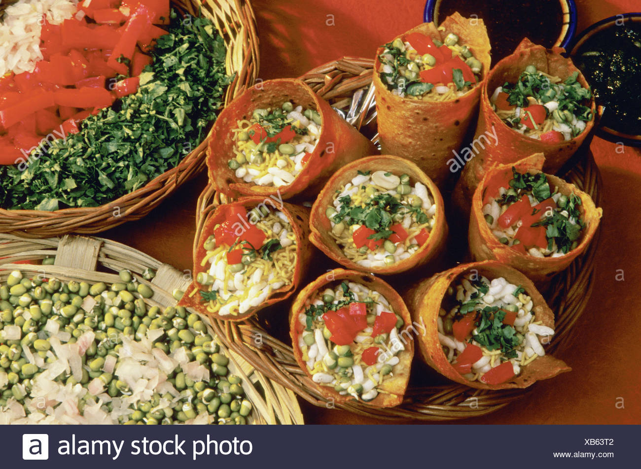 Puris with filling of spouted moog (Geminated seed). Tomatoes and onions. - Stock Image