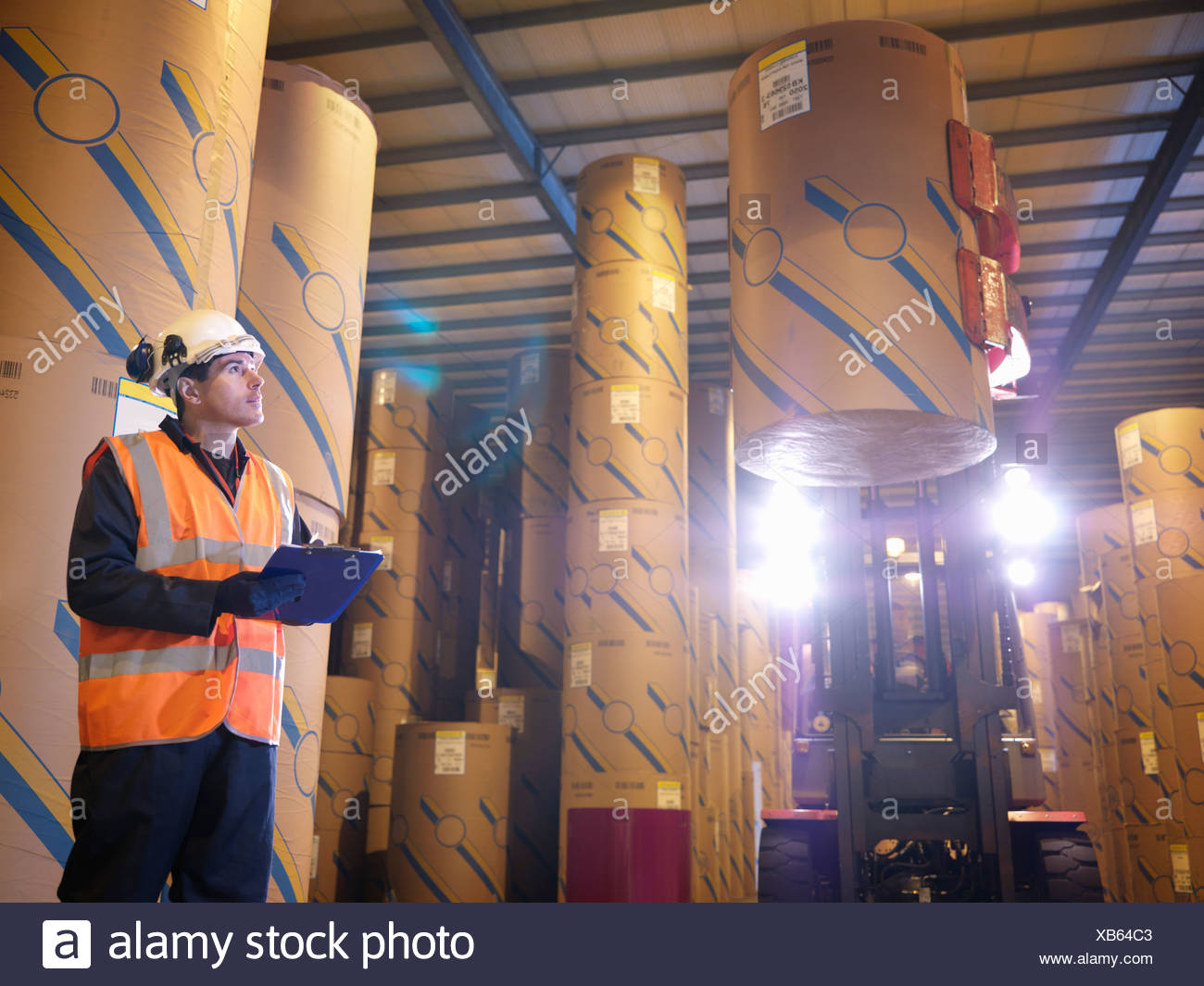 Port Worker With Clip Board & Fork Lift - Stock Image