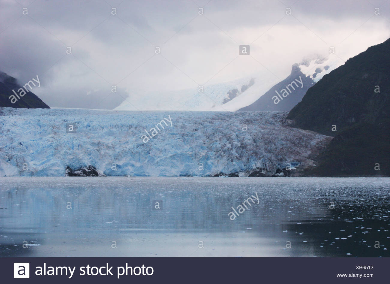 Reflection of a glacier in water, Amalia Glacier, Bernardo O'Higgins National Park, Patagonia, Chile - Stock Image