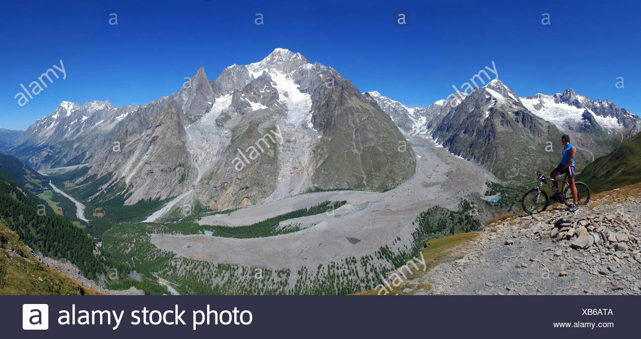 Biker in front of Monte Bianco (Mont Blanc), Val Veny, Aosta Valley, Italy, - Stock Image