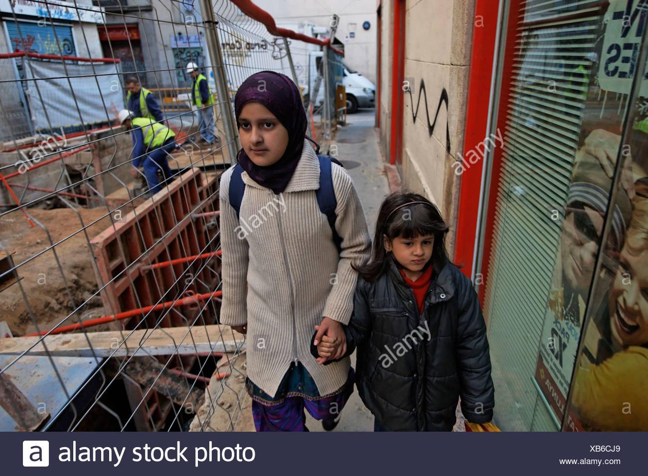 Immigrant children in Barcelona's Rambla de Raval. - Stock Image