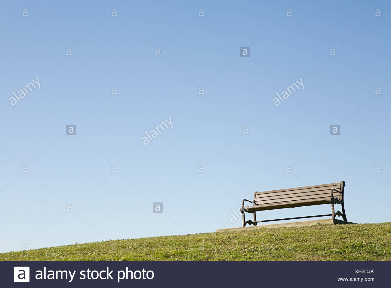A bench on a hill - Stock Image