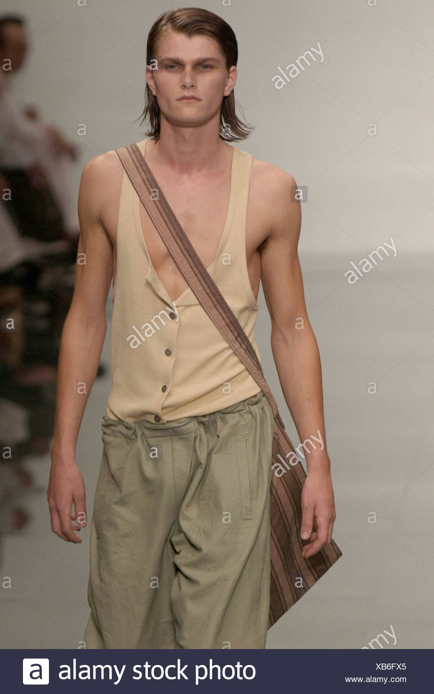 e93a16a76987 Burberry Ready to Wear Milan spring summer Menswear fashion show Model long  dark hair wearing beige