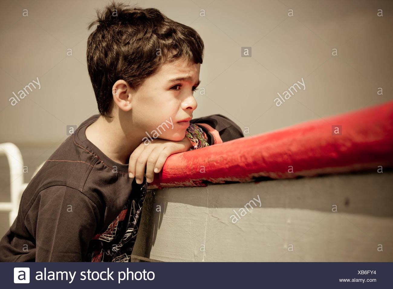 Spain, Portrait of melancholic boy - Stock Image