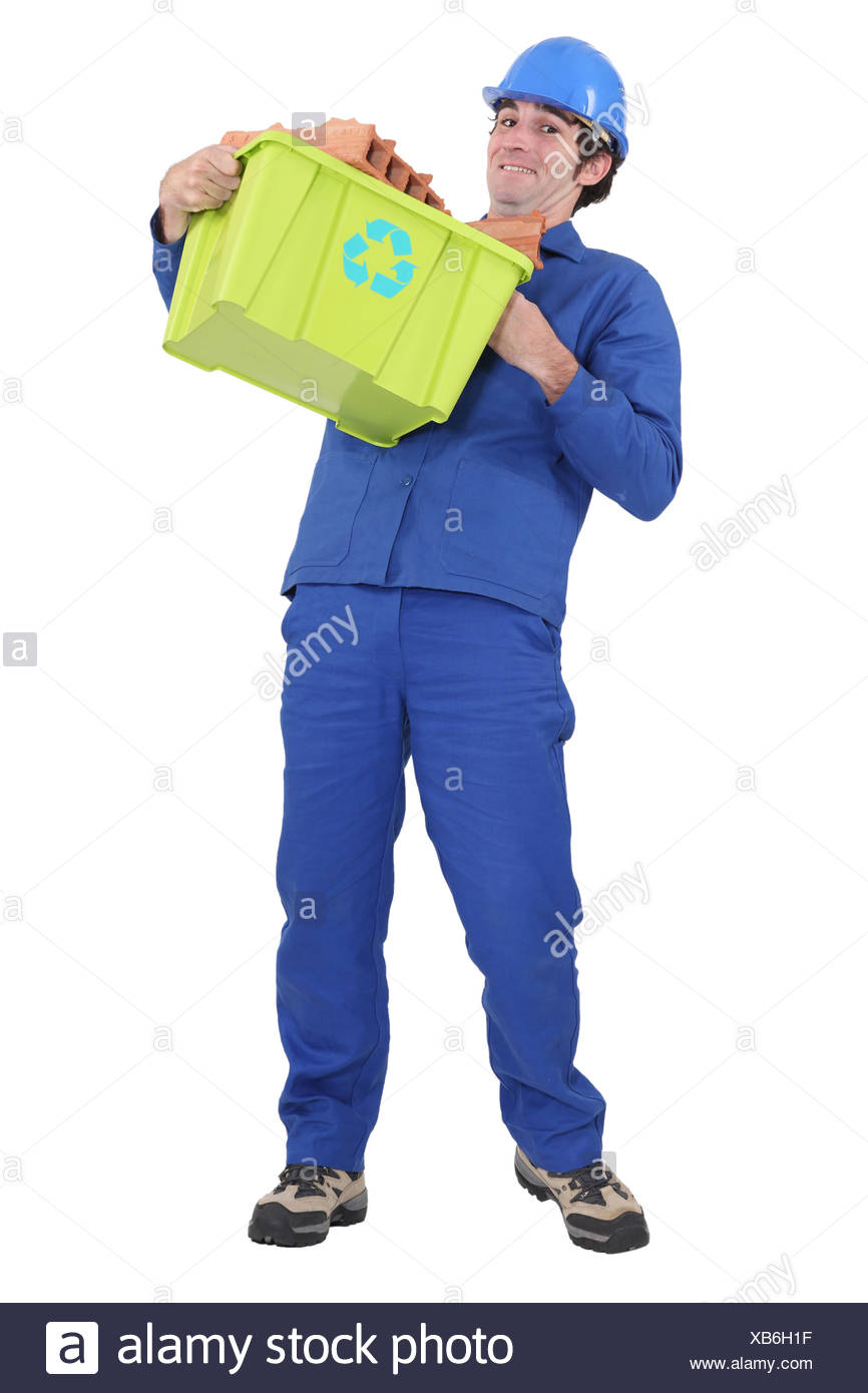 Man carrying recycled waste - Stock Image