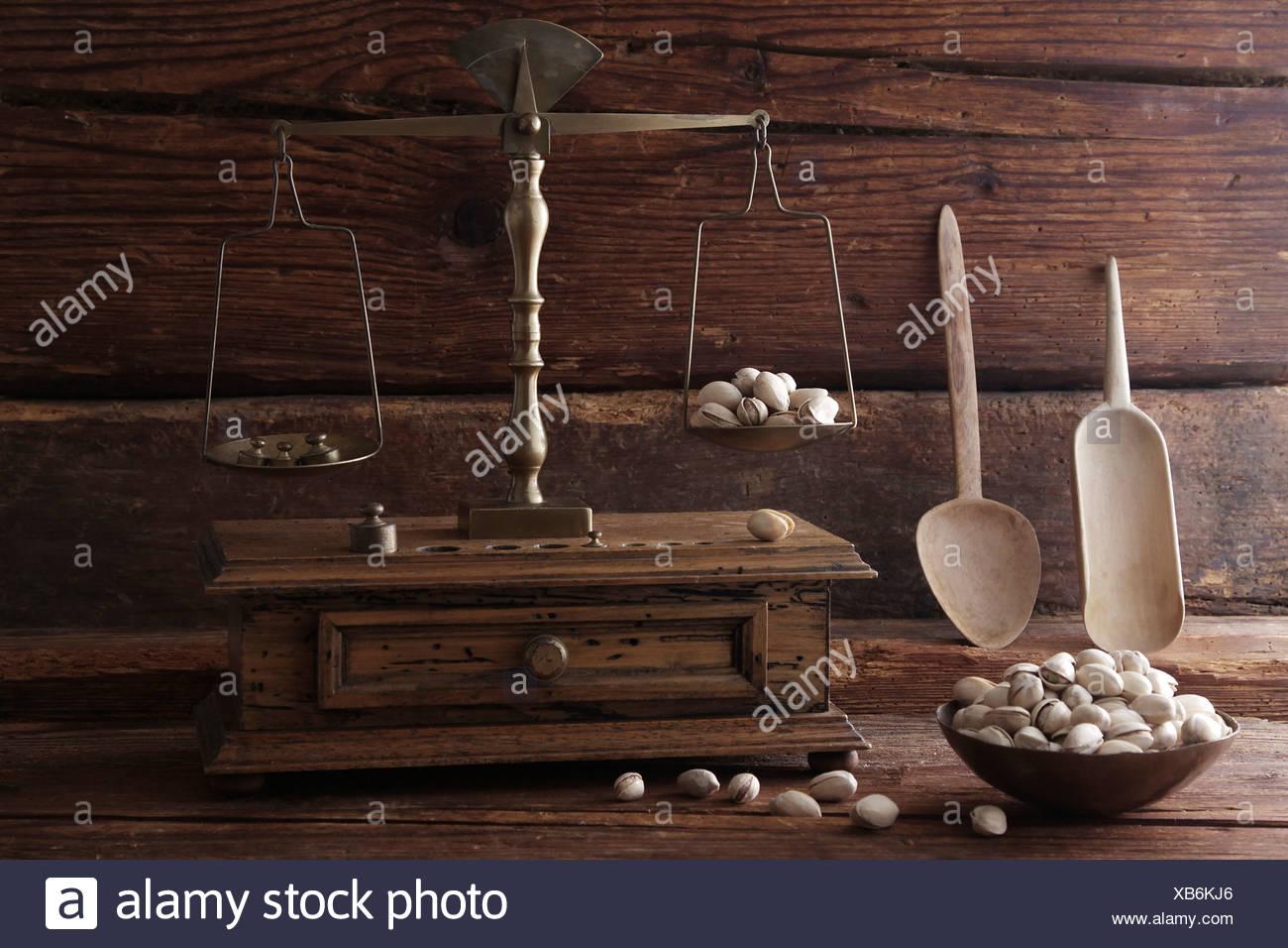 Antique scales weighing Pistachio (Pistacia vera) Stock Photo