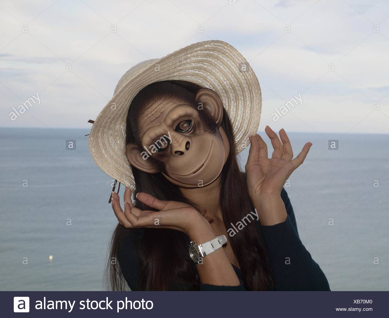 Woman Wearing Mask By Sea Against Sky - Stock Image
