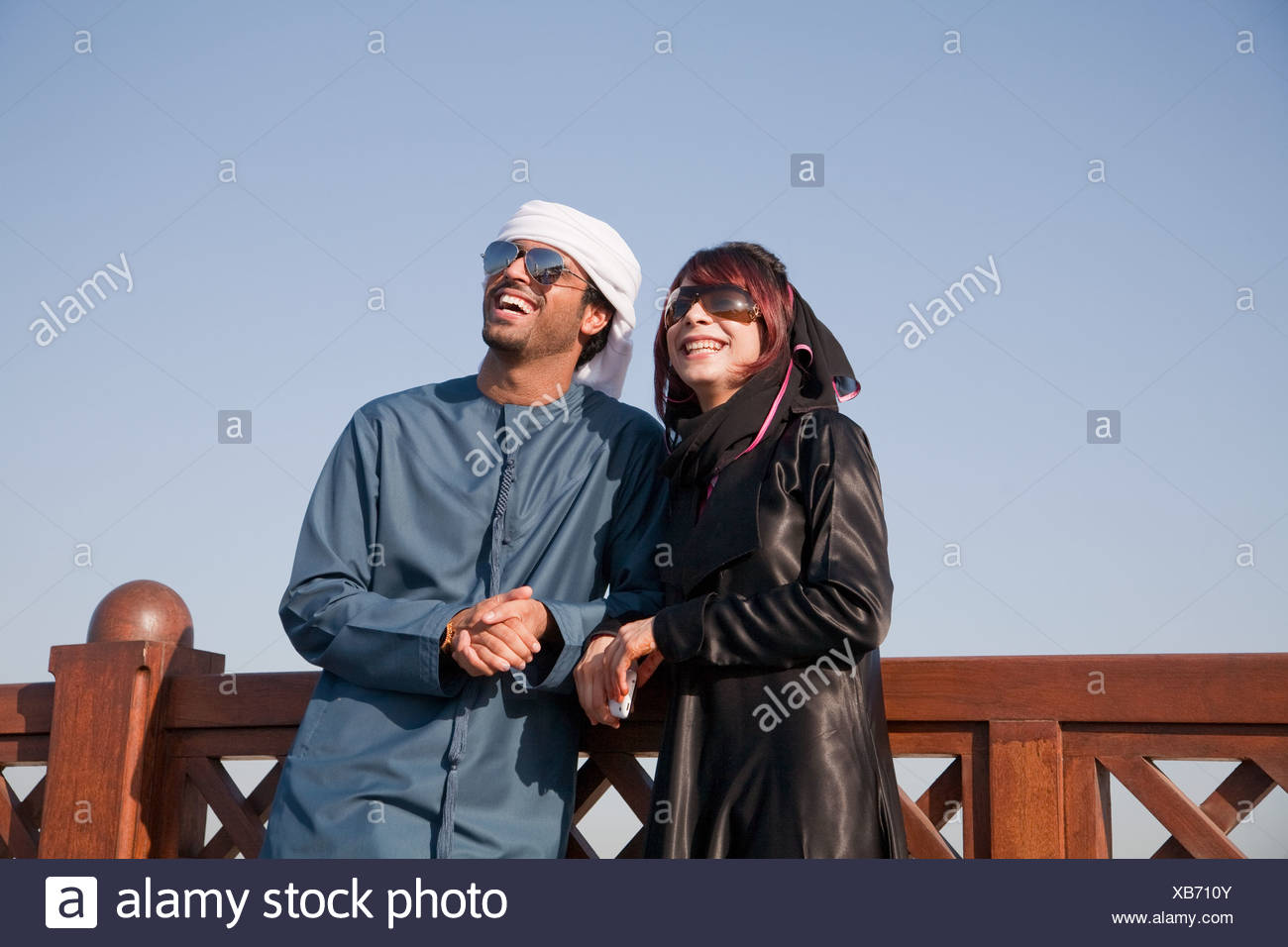 Middle Eastern people and fence, outdoors - Stock Image