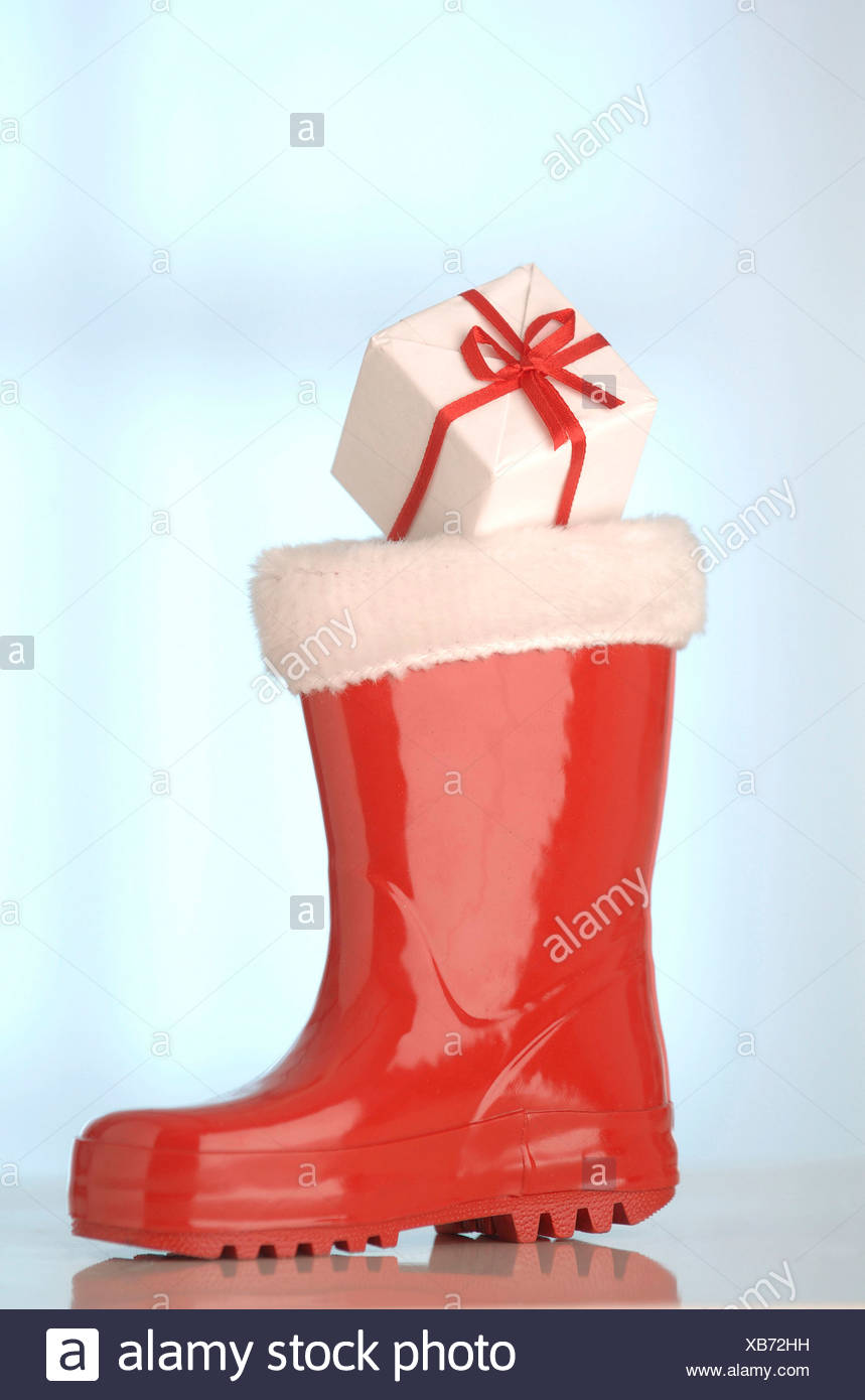 Red rubber Santa Claus boot with a gift Stock Photo