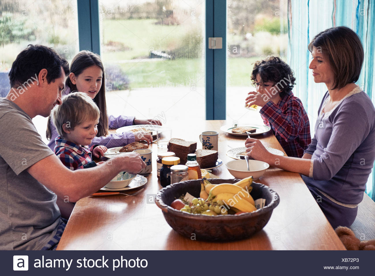Family having dinner together at table Stock Photo