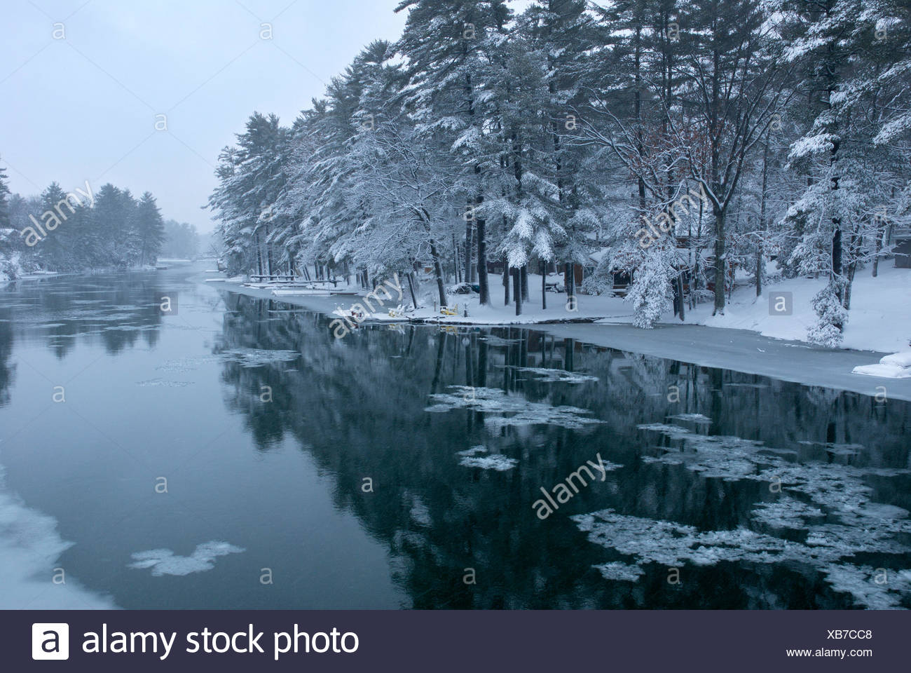 Early winter snow on the severn river in Cottage country, Muskoka, Ontario - Stock Image
