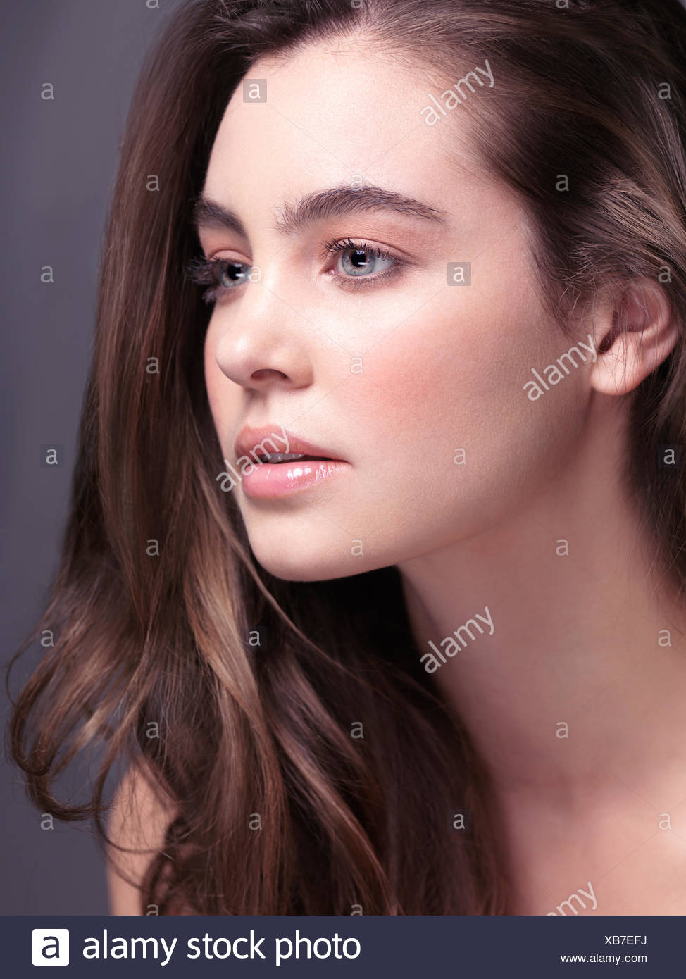 Beauty Portrait Of A Young Woman With Grey Eyes And Long