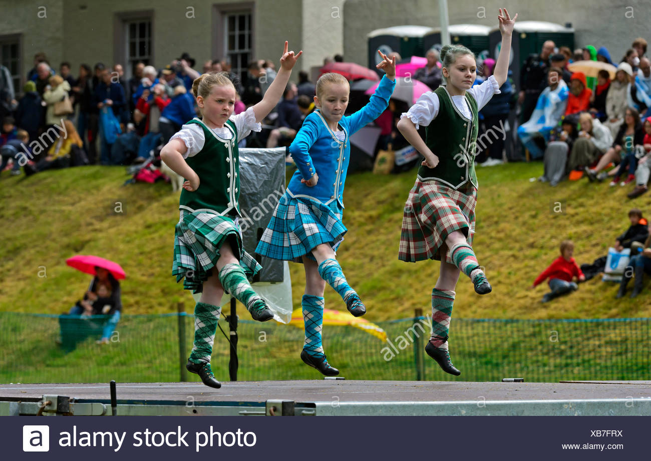 Girls dancing in kilts at a folk dance competition, Ceres Highland Games, Ceres, Scotland, United Kingdom - Stock Image