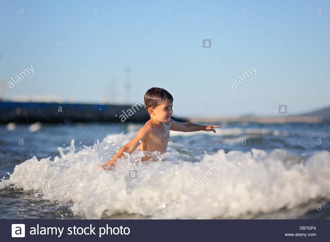 Boy playing in the sea Stock Photo