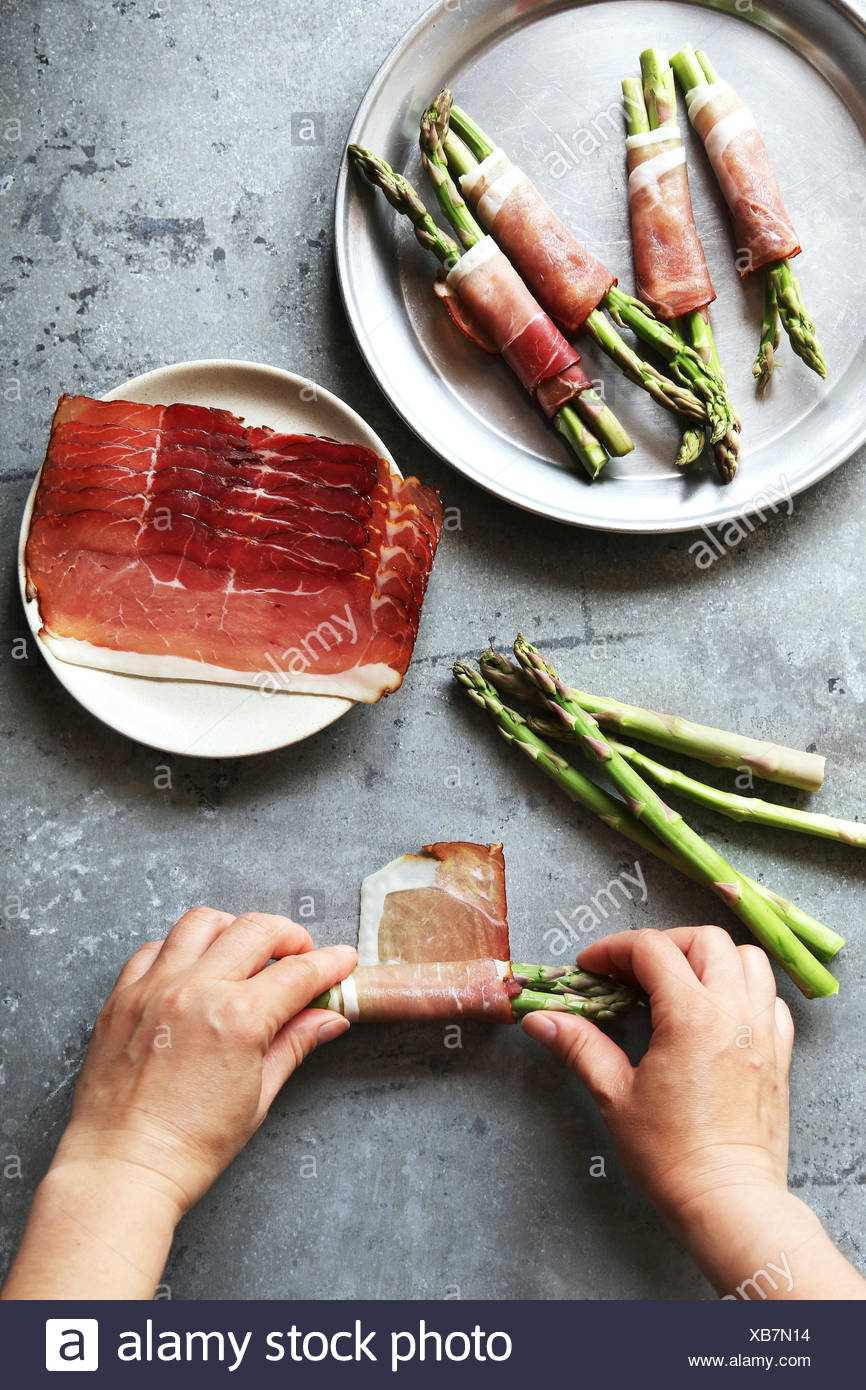 Making ham wrapped asparagus.Top view. - Stock Image
