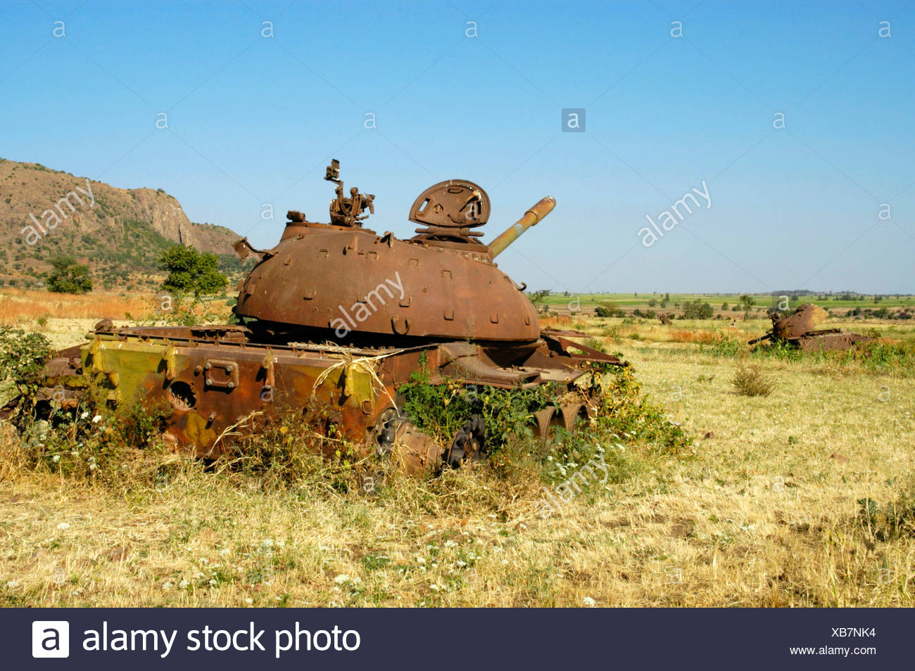 War, rusted old Russian tank lying in a field near Aksum, Ethiopia, Africa Stock Photo