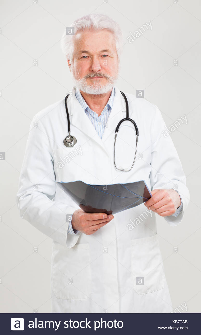 Handsome elderly doctor with radiograph - Stock Image