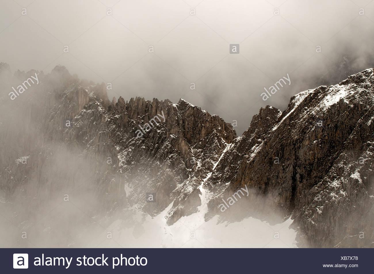 Misty mountain landscape, Nordkette, Karwendel Mountains, Tyrol, Austria, Europe - Stock Image