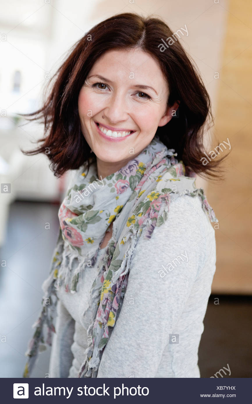 woman smiling at viewer - Stock Image