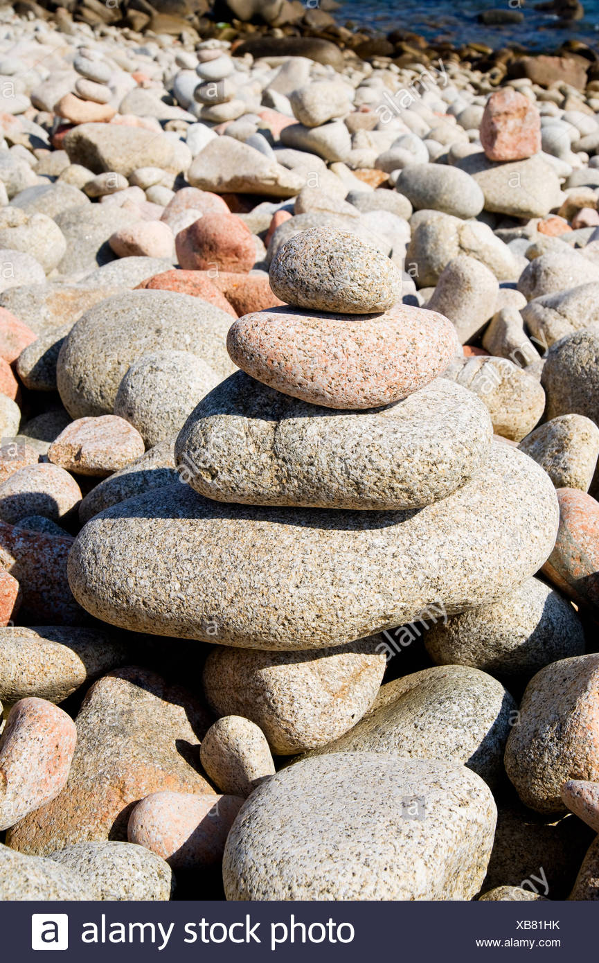Stack of pebbles on beach - Stock Image