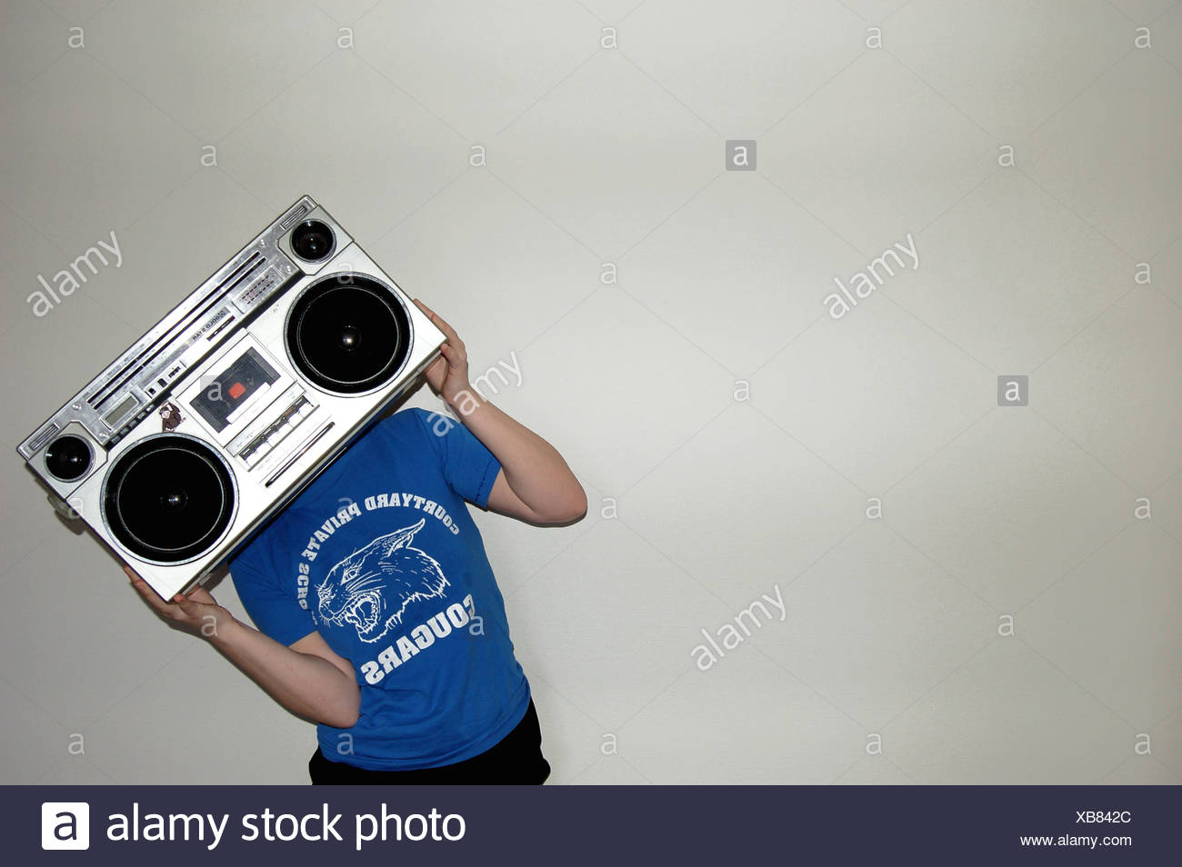 adolescent,sound,listening to music - Stock Image