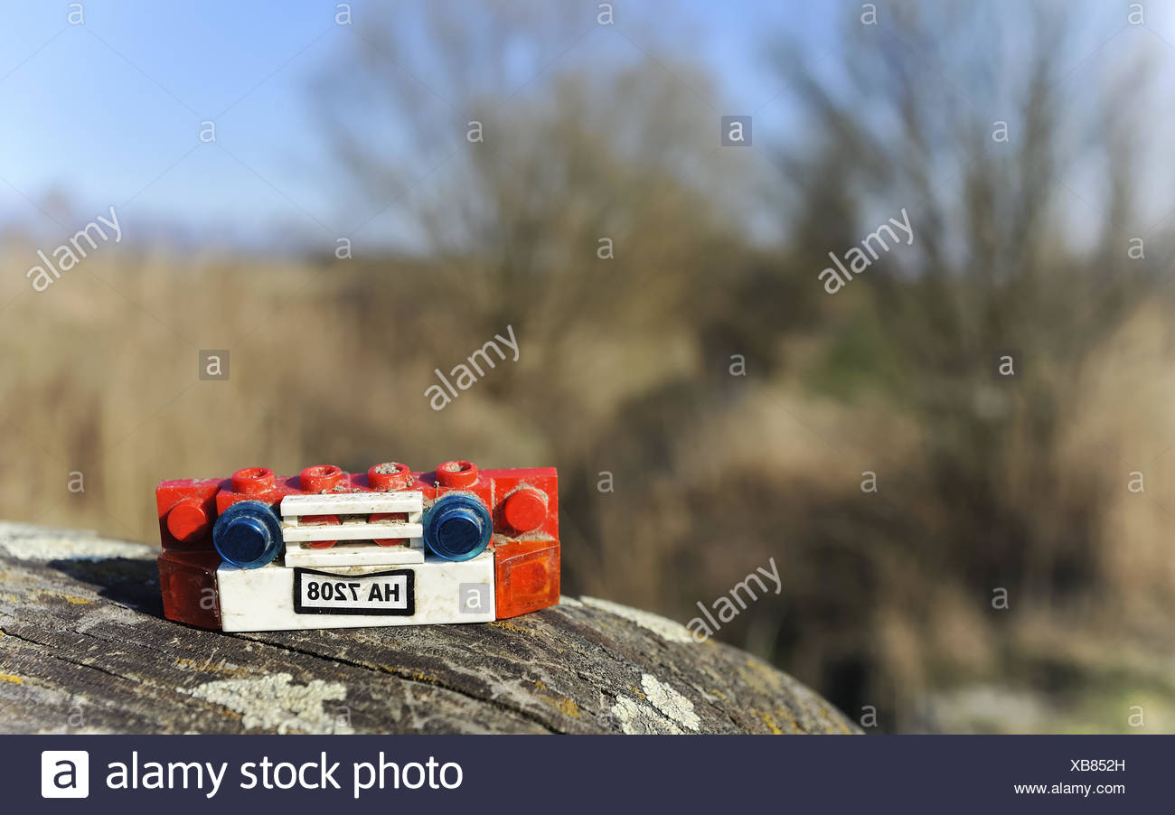 Playing outdoors with Model car - Stock Image
