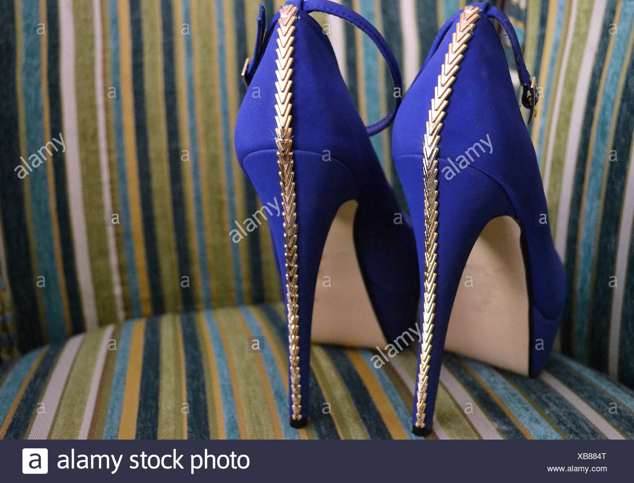 Close-Up Of Blue High Heels In Chair - Stock Image